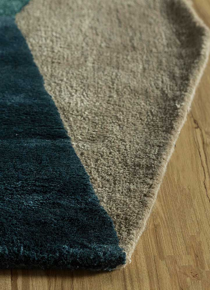 come around blue wool and viscose hand tufted Rug - Corner