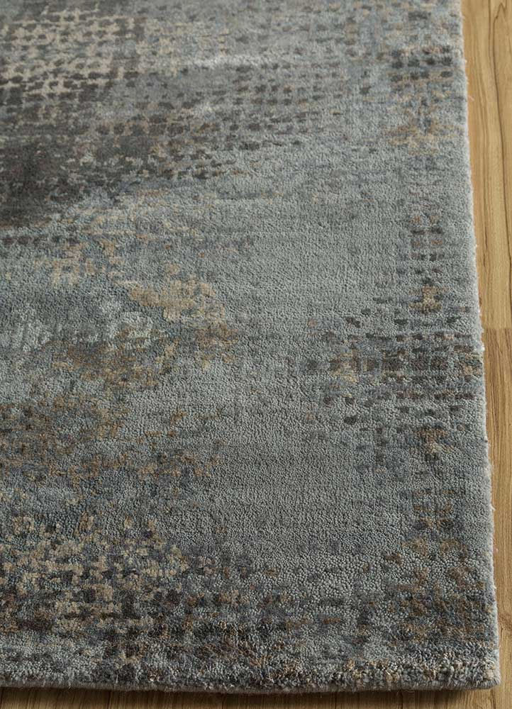 hidden by kavi blue wool and silk hand knotted Rug - Corner