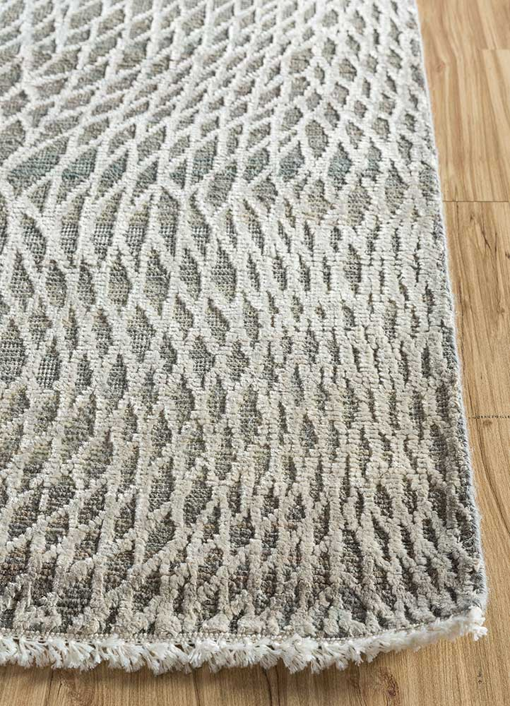 entropy blue wool and silk hand knotted Rug - Corner