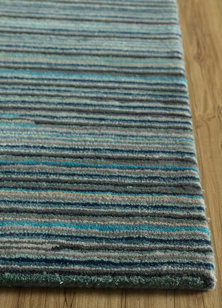 shudd blue wool and viscose hand tufted Rug - Corner